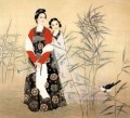 Chinese maiden in reed field and bird