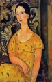 young woman in a yellow dress madame modot 1918 Amedeo Modigliani
