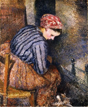 1883 Works - peasant woman warming herself 1883 Camille Pissarro