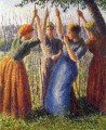 peasant women planting stakes 1891 Camille Pissarro