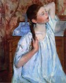 Girl Arranging Her Hair mothers children Mary Cassatt