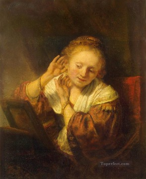 Rembrandt van Rijn Painting - Young Woman Trying Earrings Rembrandt