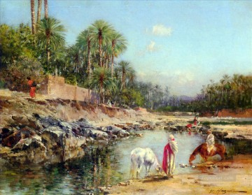 Figures Standing By A Caravan Victor Huguet Orientalist Oil Paintings