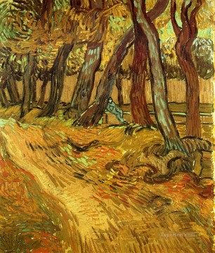 Vincent Van Gogh Painting - The Garden of Saint Paul Hospital with Figure Vincent van Gogh