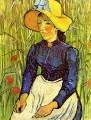 Young Peasant Girl in a Straw Hat sitting in front of a wheatfield Vincent van Gogh