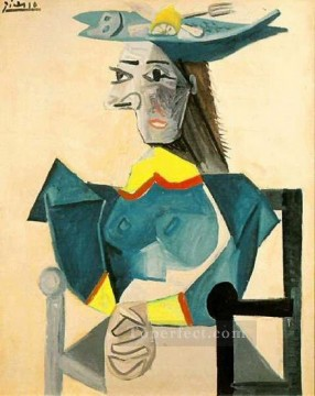 Femme assise au chapeau poisson 1942 Cubism Oil Paintings