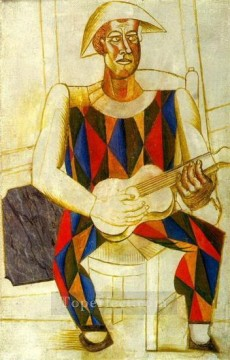 Arlequin assis a la guitare 1916 Cubists Oil Paintings