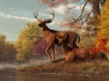deer on an autumn lakeshore