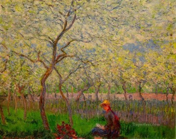 Impressionism Flowers Painting - An Orchard in Spring Claude Monet Impressionism Flowers