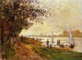 The Riverbank at Le Petit Gennevilliers Sunset Claude Monet scenery