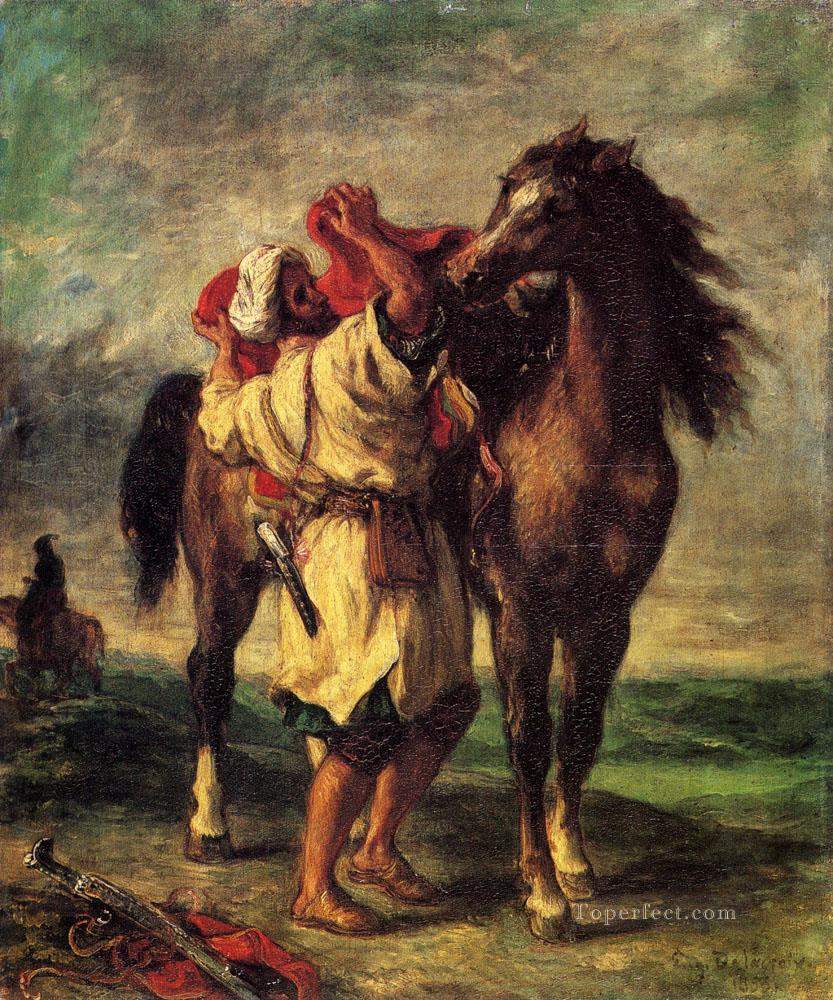 Ferdinand Victor Eugene A Moroccan Saddling A Horse Romantic Eugene Delacroix Oil Paintings